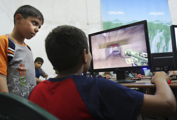 Kids playing computer games (photo by Adel Hana)